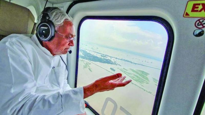 Bihar chief minister Nitish Kumar takes a survey of the flood-hit areas, in Patna, Friday. (Photo: PTI)