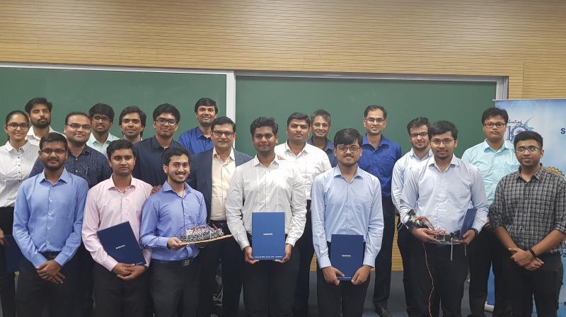 Dr. Hemant Borkar, SESC Convener, IIT Indore 3rd prize winners- Nemath Ahmed, Suraj Polamaina, Shavez Malick, Dr. Aloknath De, Samsung R&D Bangalore (Centre), Dr. Mukesh Kumar, Associate Professor- IIT Indore, Dr. Abhishek Srivastava, Associate Professor- IIT Indore, 1st Prize Winner- Ram S. Mohril, Dr. Ajit Bopardikar, Samsung R&D Bangalore and Second Prize winner Chaitanya Mehta- (Extreme Right)