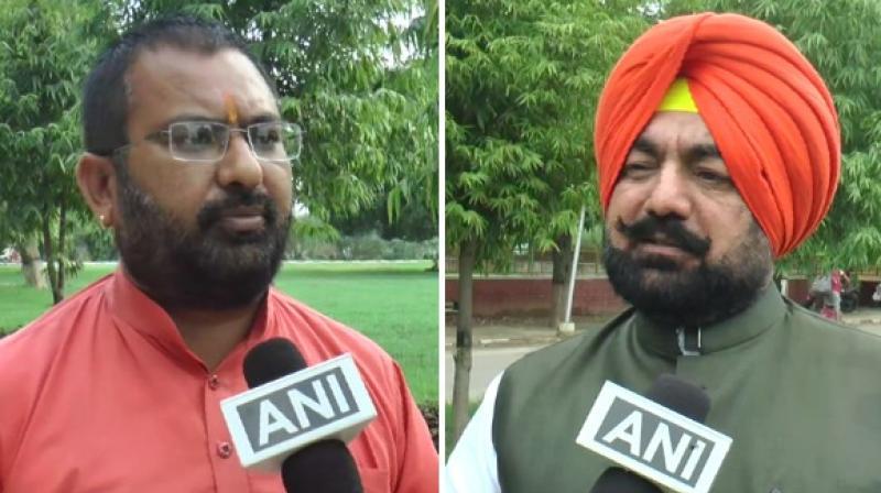 Varun Mehta, the Pradesh Head of Hindu Tatva (L) and Sukhminder Pal Singh Grewal (R), the National Secretary of BJP KIssan Morcha. (Photo: ANI)