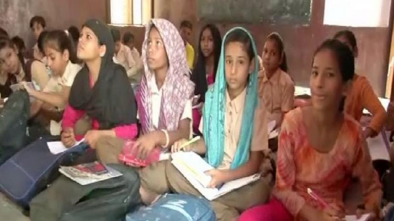 The school conducts classes for the students of Cass I to VIII and is run in two shifts where these students are taught lessons in Urdu and the Quran in the morning followed by Sanskrit 'shlokas' in the afternoon. (Photo: ANI)