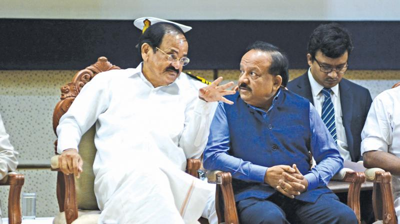 Vice President M Venkaiah Naidu interacts with minister Harsh Vardhan at an event in Chennai on Sunday.  (DC)
