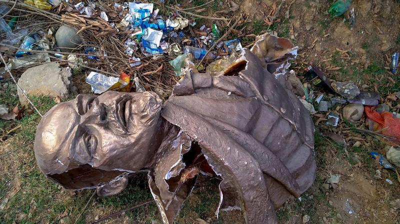 Remains of the five-feet-tall statue of Lenin which was allegedly demolished by a pay-loader at Belonia in South Tripura district on Monday afternoon and was thrown at the nearby jungle. (Photo: PTI)
