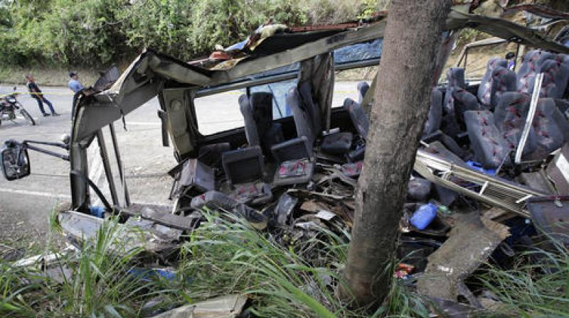 The out-of-control bus smashed into an electric post, shearing off most of its roof. (Photo: AP)