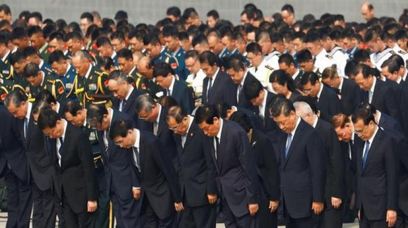 Xi and other top officials visited Maos' mausoleum which is located in Tiananmen Square in Beijing and bowed three times to the late leader's statues. (Photo: ANI)