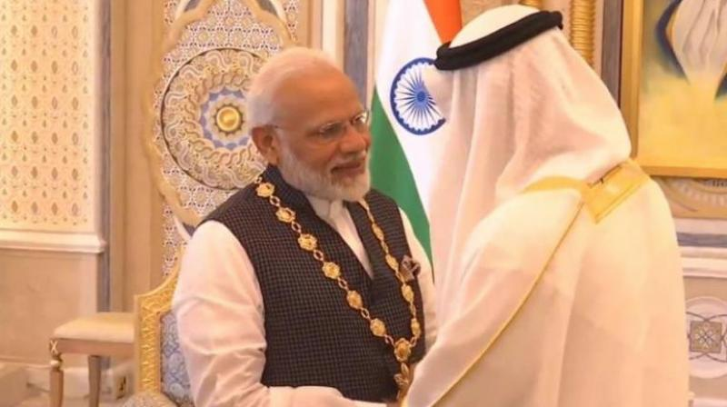 """The """"Order of Zayed""""award was conferred on PM Modi by the Abu Dhabi Crown Prince Sheikh Mohamed bin Zayed Al Nahyan in a ceremony held at the Presidential Palace in Abu Dhabi. (Photo: ANI)"""