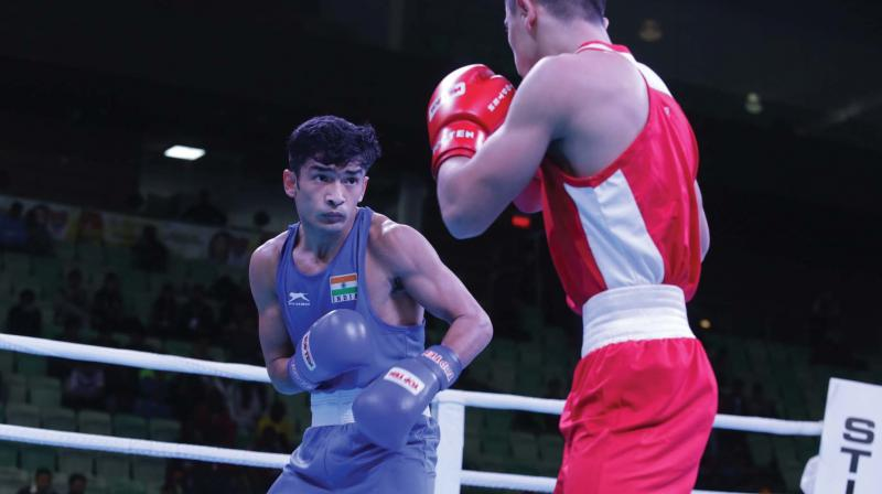 Shiva Thapa (left) in action against Rakhmatulloev Sherbek of Uzbekistan in their India Open semi-final bout in New Delhi on Tuesday.