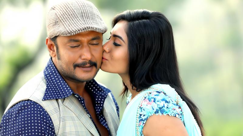 Darshan and Deepa Sannidhi in a still from 'Chakravarthy.'