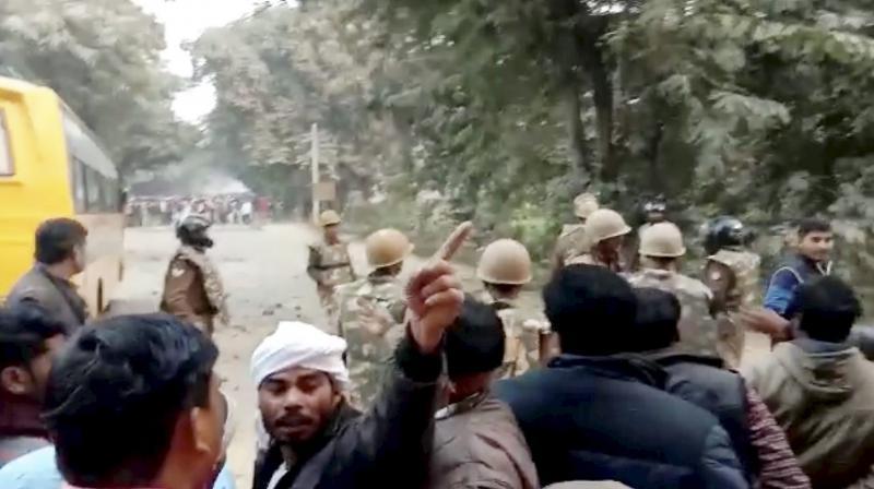 Uttar Pradesh police personnel tackle protestors following Prime Minister Narendra Modi's rally in Ghazipur on Saturday. (Photo: PTI)