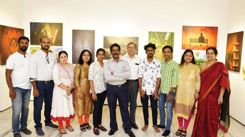 Suresh T.R.(middle) with the artists whose paintings are exhibited at Time after Time