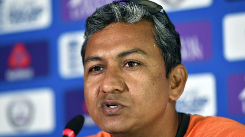 India's assistant coach Sanjay Bangar on Monday came to the defence of the under-fire Mahendra Singh Dhoni, saying losing wickets at regular intervals did not allow the veteran campaigner to play freely in the second ODI at Lord's. (Photo: AP)
