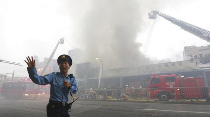The fire broke out at a three-story building around 1:20 pm IST (0750 GMT), burning around 200 square metres (2,150 square feet) of the area, public broadcaster NHK said. (Photo: AP)