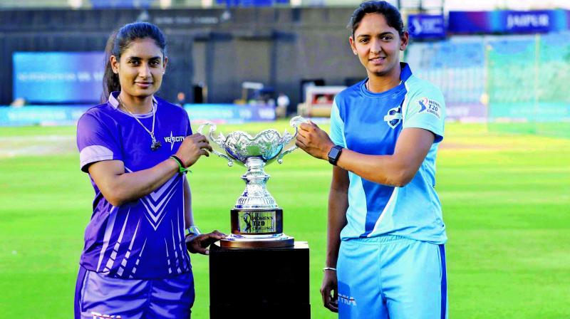 Velocity skipper Mithali Raj (left) and her Supernovas counterpart Harmanpreet pose with the Women's T20 Challenge trophy. (Photo: BCCI)