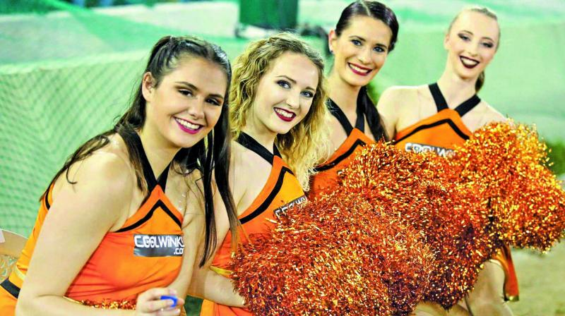 Cheerleaders of Sunrisers Hyderabad pose during a match. (Photo: AFP, BCCI)