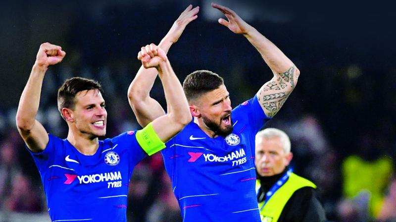 Chelsea's Cesar Azpilicueta (left) and Olivier Giroud celebrate their win over Frankfurt in the Europa League semifinal second leg at Stamford Bridge in London on Thursday. (Photo: AFP)