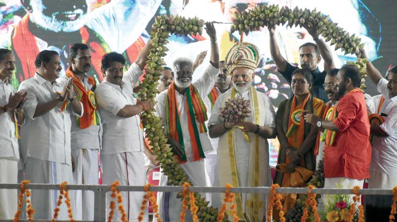 Prime Minister Narendra Modi being garlanded by BJP leaders at Central Stadium in Thiruvananthapuram where he address an election rally on Thursday. NDA candidates in Thiruvananthapuram and Attingal, Kummanam Rajasekharan and Sobha Surendran, BJP state president P. S. Sreedharan Pillai, BJP TVM president S. Suresh, and BJP state general secretary M.T. Ramesh are seen.—A.V. MUZAFAR
