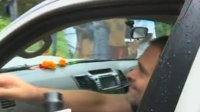 The former Congress president is no stranger to such incidents as he was also kissed by a woman supporter during a rally in Gujarat this year in February. (Photo: ANI)