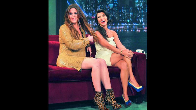 Sisters Khloe Kardashian (left) and Kourtney