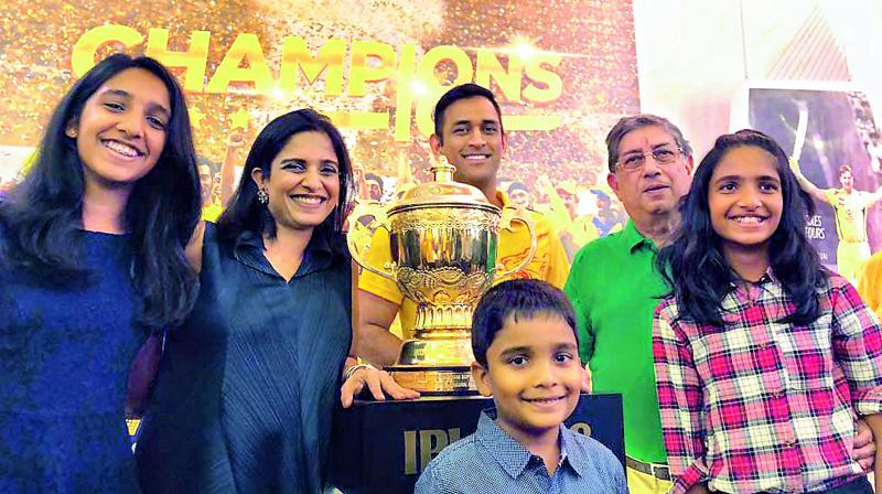 Rupa Gurunath (second from left) with MS Dhoni and  N. Srinivasan.