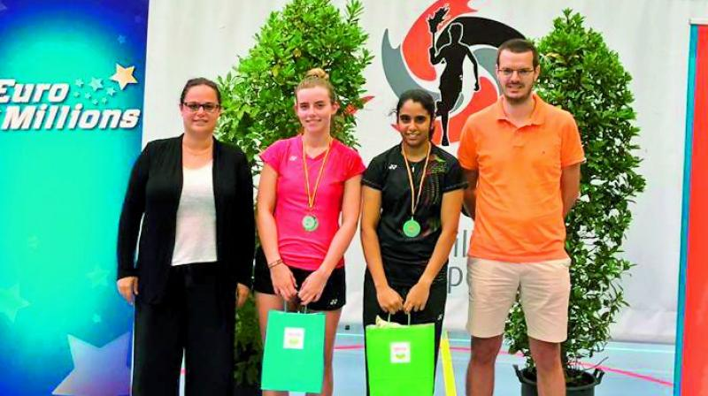 Jakka Vaishnavi Reddy (second from right) poses with runner-up Clara Lassaux and officials after winning the Belgian Juniors badminton in Herstal on Sunday.