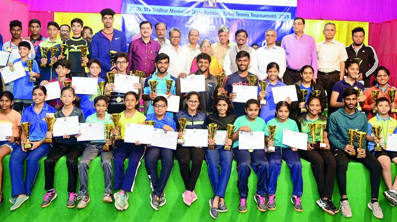Medallists pose at the conclusion of Dr M. V. Sridhar memorial Table Tennis tournament in Hyderabad.