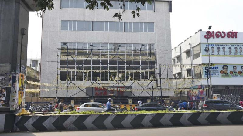 A front view of Kasi theatre with no big banners or cutouts as Suriya's Kaappan hit the screens in Chennai.  (DC)