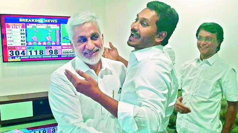 YSR Congress chief Y.S. Jagan Mohan Reddy hugs party MP Vijaya Sai Reddy as they celebrate the party's landslide victory in Andhra Pradesh Assembly elections at his camp office at Tadepalli on Thursday.