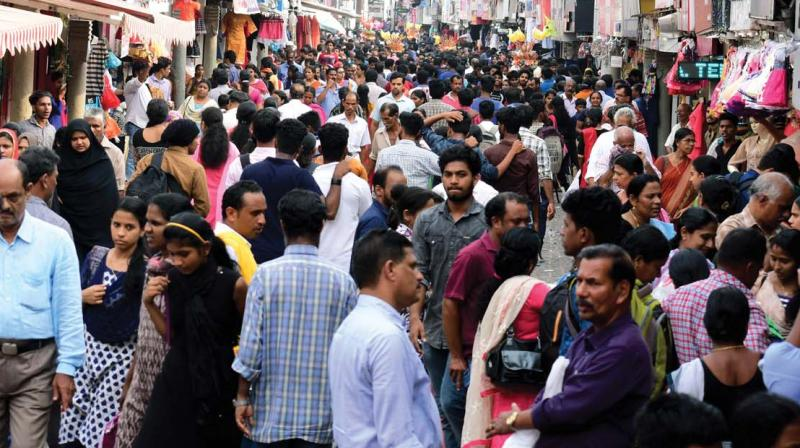 People throng SM Street for last-minute purchases on the eve of Vishu on Saturday. (Photo: DC)