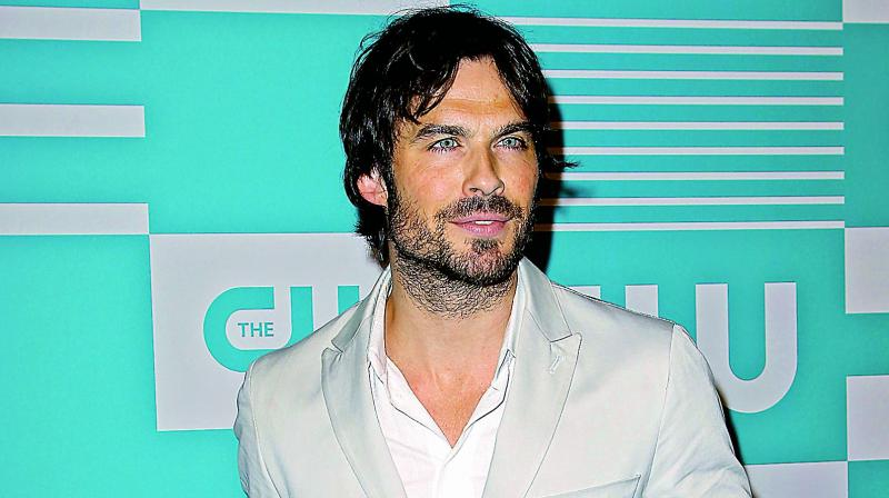 "The actor wrote alongside a photo of him and wife Nikki Reed kissing, ""Crazy wardrobe day. (Photo: DC)"
