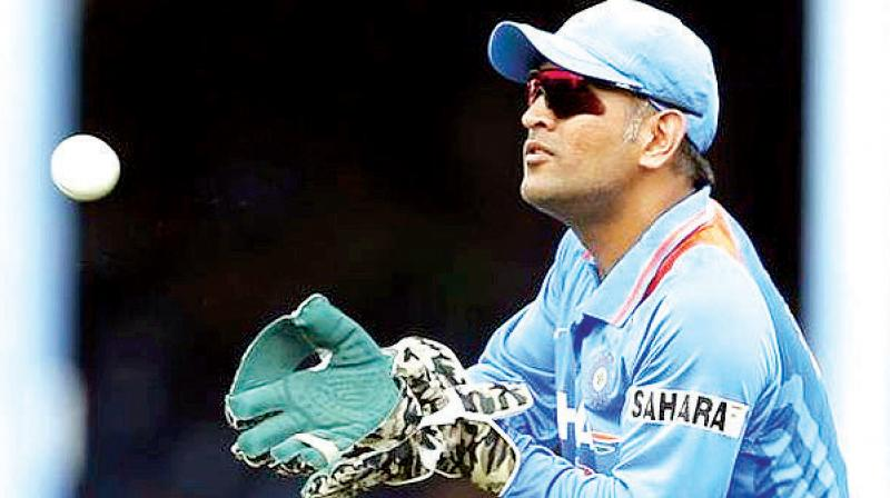 Dhoni, who will turn 38 on July 7 has been asked to remove the said logo off his gloves and is likely to hide it in the remaining World Cup matches. (Photo: File)