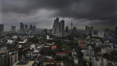 Dark clouds from a passing thunder storm is seen over the skyline. (Photo:AP)