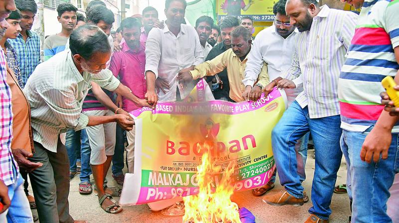 Residents and other parents protest in front of Bachpan School after Rachith drowned in an open sump at the school.  (Photo: DC)