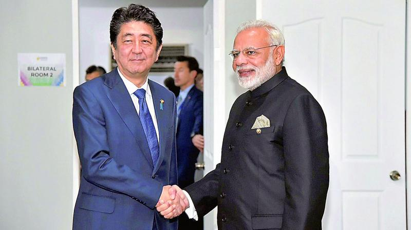 Prime Minister Narendra Modi with his Japanese counterpart Shinzo Abe, in Manila, on Tuesday. (Photo: PTI)