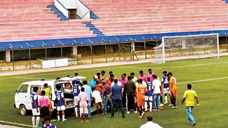 Ayush Panchamiya being treated on field