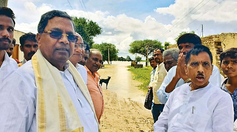 Opposition leader Siddaramaiah during a visit to flood-hit areas in Badami taluk on Wednesday.  (Photo: KPN)KPN