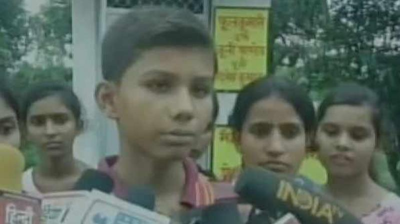 This young boy from Gonda village has gifted a toilet to his sister to avoid going out in the public. (Photo: ANI)
