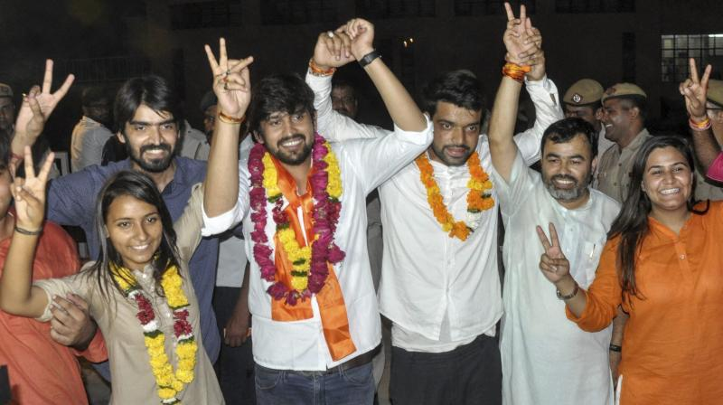 ABVP's panel's newly elected DUSU President Ankiv Basoya (3rd R) Shakti Singh (Vice President) and Joint Secretary, Jyoti Choudhary (L) celebrate after DUSU Election Result 2018. (Photo: PTI)
