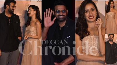 On Saturday, Prabhas and Shraddha Kapoor launched their much-awaited Saaho's trailer in Mumbai. Apart from the Baahubali actor, the Saaho trailer launch was attended by director Sujeeth, Bhushan Kumar and others. (Photos: Viral Bhayani)