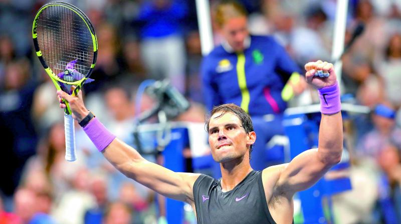 Rafael Nadal celebrates after defeating John Millman of Australia in their men's singles first round match of the US Open at the USTA Billie Jean King National Tennis Center in New York on Tuesday. (Photo: AFP)