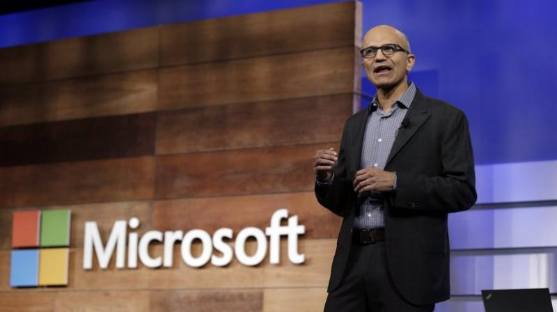 This file photo shows Microsoft CEO Satya Nadella speaking at the annual Microsoft shareholders meeting in Bellevue, Wash. Microsoft's annual Build conference for software development kicks off on Monday, May 7, 2018, giving the company an opportunity to make announcements about its computing platforms or services. The three-day event features sessions on cloud computing, artificial intelligence, internet-connected devices and virtual reality. (AP Photo/Elaine Thompson, File)