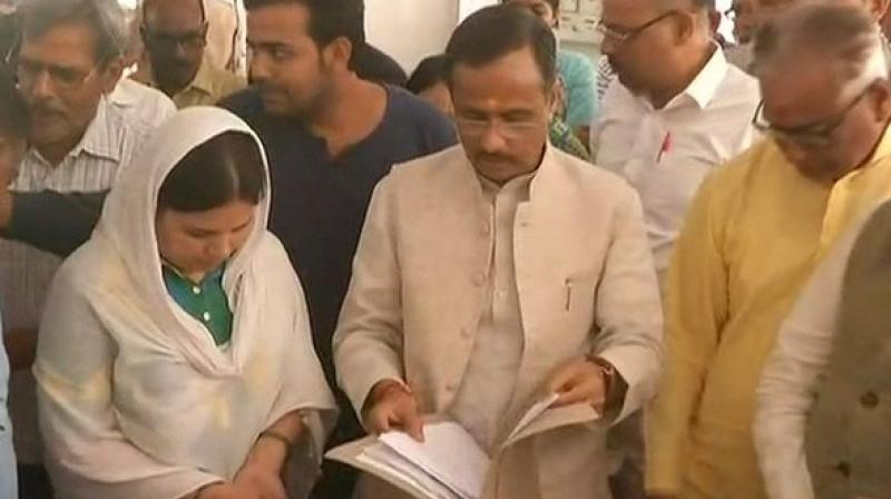UP Dy CM Dinesh Sharma handed over appointment letter for a government job to Kalpana Tiwari, wife of killed Apple executive. (Photo: ANI)