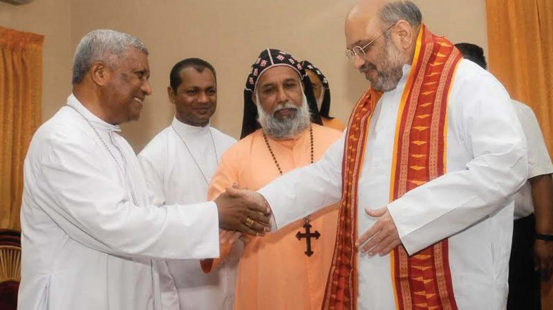 Win or else amit shah to kerala bjp leaders archbishop m soosa pakiam and catholic bishop council of india president baselios cardinal cleemis catholicos greet m4hsunfo