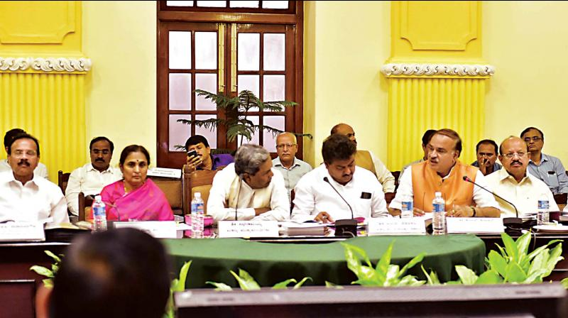 Chief Minister Siddaramaiah with Union Ministers, MPs and ministers at a meeting on the Supreme Court's Cauvery water verdict in Bengaluru on Thursday.