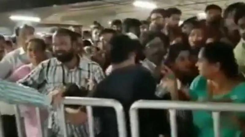 On its opening day, the store witnessed a stampede like situation as scores of people were waiting impatiently to take a sneak peek of the store. (Photo: Screengrab | ANI)