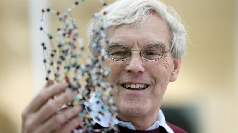 Richard Henderson, one of the 2017 Nobel Prize winners in Chemistry, holds a bacterio rhodopsin model prior to a press conference at the Laboratory of Molecular Biology in Cambridge, England, Wednesday, Oct. 4, 2017. Three researchers based in the US, UK and Switzerland won the Nobel Prize in Chemistry on Wednesday for developments in electron microscopy. The 9-million-kronor ($1.1 million) prize is shared by Jacques Dubochet of the University of Lausanne, Joachim Frank at New York's Columbia University and Richard Henderson of MRC Laboratory of Molecular Biology in Cambridge, Britain. (Frank Augstein/Associated Press)