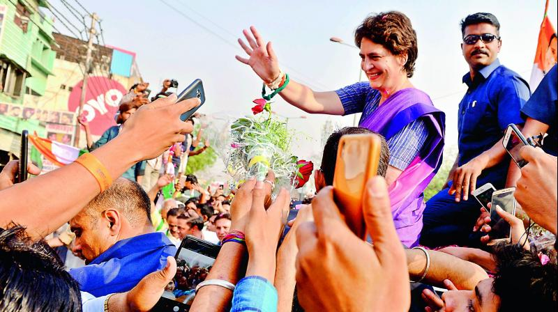 AICC general secretary Priyanka Gandhi Vadra waves to her supporters during the roadshow, ahead of the Lok Sabha polls, in Ghaziabad on Friday. 	(Photo: ANI)