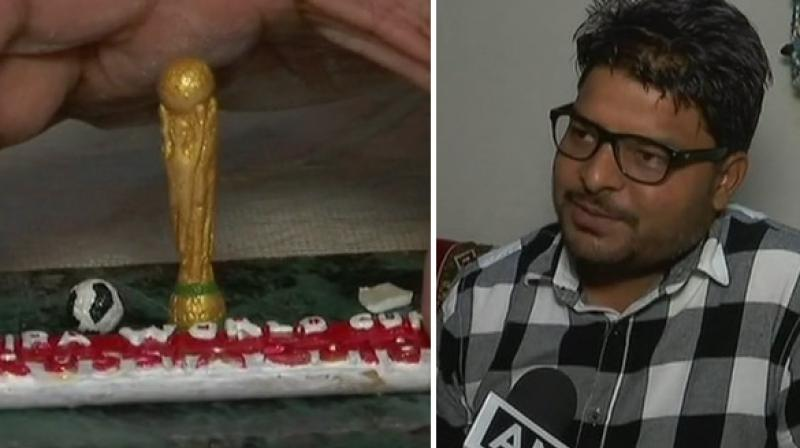 'I wanted to combine my crafting talent and passion for football to create something new. I am a huge fan of the game and that is why I chose to carve the FIFA world cup trophy,' Singh said. (Photo: ANI)