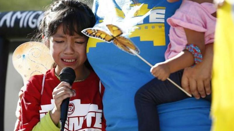 Akemi Vargas, 8, cries as she talks about being separated from her father during an immigration family separation protest in front of the Sandra Day O'Connor US District Court building, in Phoenix. (Photo: AP)