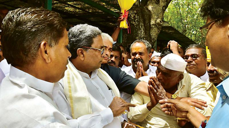 Chief Minister Siddaramaiah listens to the grievances of people during 'Janata Darshan' in Bengaluru on Tuesday – DC