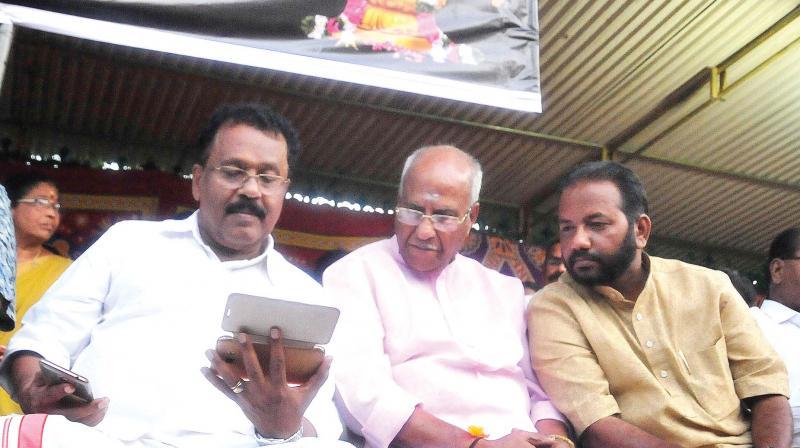 BJP state president P.S. Sreedharan Pillai, O. Rajagopal, MLA, and district president S. Suresh watch live footage of Pinarayi Vijayan's speech at Kannur, during the Akhanda Nama Japa in front of Secretariat in Thiruvananthapuram on Monday.