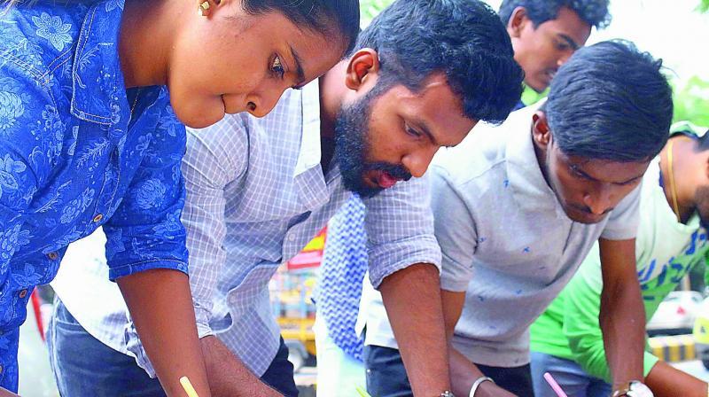 Members of Vijayawada Needs U take part in 1 lakh postcards campaign demanding justice to Andhra Pradesh on Saturday. (Photo: DC)